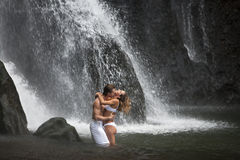 Couple Hugging Under Waterfalls Royalty Free Stock Photography