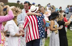 Couple hugging at The Virginia Gold Cup stock images