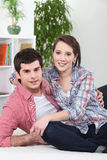 Couple hugging on white sofa Stock Photo