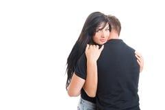 Couple hugging on white studio background Royalty Free Stock Image