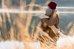 Couple hugging winter. Back view of lovely young couple hugging in winter stock photo