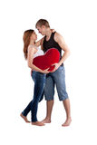Couple Hugging With A Red Heart Royalty Free Stock Images