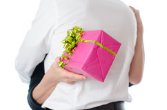 Couple hugging, woman holding a gift Stock Images