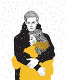 couple hugs under the snow stock photo
