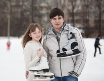 Couple on ice skate rink outdoors. Royalty Free Stock Photography