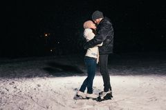 Couple ice skating outdoors on a pond night. Couple ice skating outdoors on a pond on night Stock Photos