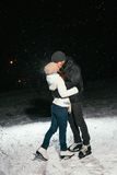 Couple ice skating outdoors on a pond night Royalty Free Stock Photo