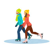 Couple Ice Skating together on ice rink. Holding hands Royalty Free Stock Photo