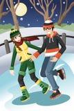 Couple ice skating Royalty Free Stock Image