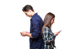 Couple ignore each other. While use their phone Royalty Free Stock Photos