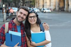Couple of immigrants getting a proper education royalty free stock image
