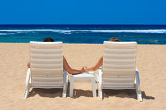 Couple In Beach Chairs Royalty Free Stock Images