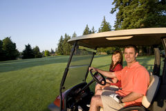 Couple In Cart On Golf Course - Horizontal Stock Photos
