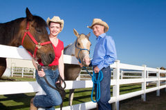 Couple In Cowboy Hats With Horses - Horizontal Stock Photography