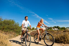 Couple In Holidays Cycling Stock Images