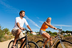 Couple In Holidays Cycling Royalty Free Stock Image