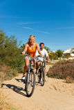 Couple In Holidays Cycling Royalty Free Stock Photos