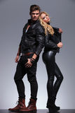 Couple In Leather Clothes Standing Back To Back Stock Photo