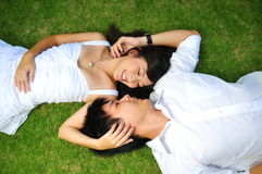 Couple In Love Lying On The Grass Royalty Free Stock Image