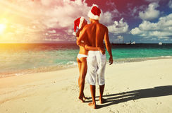 Free Couple In Santa S Hat On A Beach At Maldives Stock Photo - 60604040