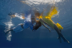 Couple In The Swimming Pool Royalty Free Stock Photos