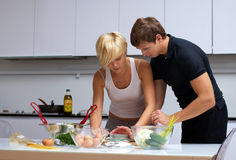 Couple In Their Kitchen Making Dinner Stock Photography