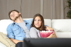 Couple incompatibility problems watching tv Royalty Free Stock Image
