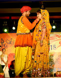Couple With Indian Traditional Drees. Model at the fashion stage during collage function Stock Image
