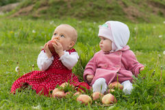 Couple of infant kids with apples Stock Image