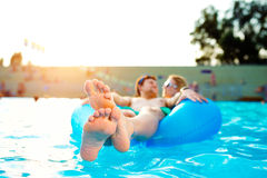 Couple in inflatable ring in pool. Summer and water. Royalty Free Stock Image
