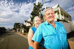 Couple infront of House Stock Photography