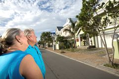 Couple infront of House Stock Photo