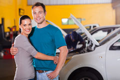 Couple inside garage stock photography