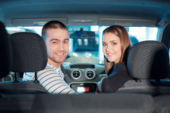 Couple inside the new vehicle in showroom Royalty Free Stock Image