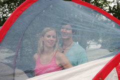 Couple inside tent. Behind mesh Royalty Free Stock Images