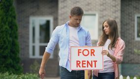 Couple installing for rent signboard, family needs additional income, crisis. Stock footage stock video