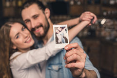 Couple with instant photo Stock Photos