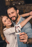 Couple with instant photo Royalty Free Stock Photography