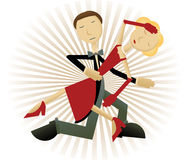 Couple intensive dancing accented by raybeam. Classically dressed dancing couple in retro dark shades Stock Photos