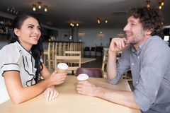 Couple interacting with each other in cafeteria Stock Photos