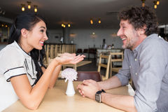 Couple interacting with each other in cafeteria Stock Image