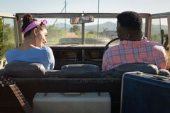 Couple interacting with each other in car. At countryside Royalty Free Stock Image