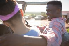 Couple interacting with each other in car. At countryside Royalty Free Stock Photography