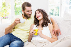 Couple interacting with each other while having coffee Royalty Free Stock Photo