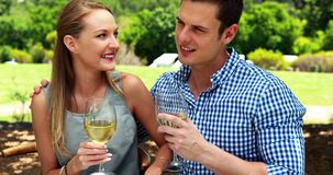 Couple interacting with each other while having glasses of wine 4k stock video footage