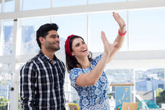 Couple interacting with each other in the office. Young couple interacting with each other in the office Royalty Free Stock Photo