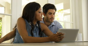 Couple interacting with each other while using digital tablet stock video footage