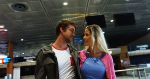 Couple interacting with each other while walking. In airport stock video footage