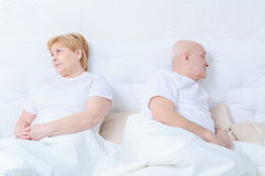 Couple interacts in bed royalty free stock images