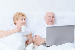 Couple interacts in bed Stock Photo